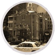 Round Beach Towel featuring the photograph Denver Downtown With Yellow Cab Sepia by Frank Romeo