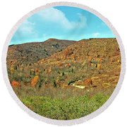 Round Beach Towel featuring the photograph Devils Courthouse by Susan Leggett