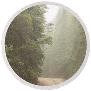 Round Beach Towel featuring the photograph Dirt Road Challenge Into The Mist by James BO Insogna