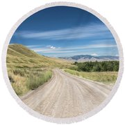 Dirt Road Through Mountains Round Beach Towel