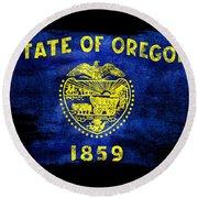 Distressed Oregon Flag On Black Round Beach Towel by Jon Neidert