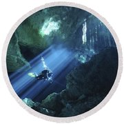 Diver Silhouetted In Sunrays Of Cenote Round Beach Towel by Karen Doody