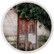 Round Beach Towel featuring the photograph Door Covered With Ivy by Marco Oliveira