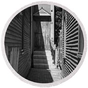 Door In An Alley Round Beach Towel by Kevin Fortier