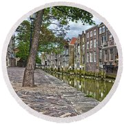 Round Beach Towel featuring the photograph Dordrecht Behind The Church by Frans Blok
