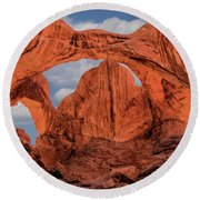 Round Beach Towel featuring the photograph Double Arches At Arches National Park by Penny Lisowski