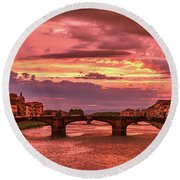 Saint Trinity Bridge From Ponte Vecchio At Red Sunset In Florence, Italy Round Beach Towel