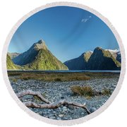 Round Beach Towel featuring the photograph Driftwood In Milford Sound by Gary Eason
