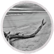 Round Beach Towel featuring the photograph Driftwood On The Beach In Black And White by Paul Ward