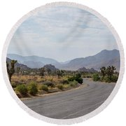 Driving Through Joshua Tree National Park Round Beach Towel