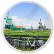 dutch windmills with bikes in Zaanse Schans Round Beach Towel