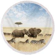 Elephants And Zebras In The Grasslands Of The Masai Mara Round Beach Towel