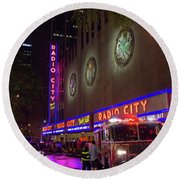 Round Beach Towel featuring the photograph Emergency At Radio City by RKAB Works