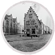 Empty Streets In Bruges On A Misty Morning Round Beach Towel
