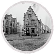 Round Beach Towel featuring the photograph Empty Streets In Bruges On A Misty Morning by Barry O Carroll