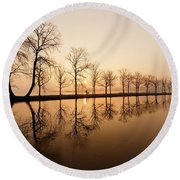 Endlessness - Silhouette Reflected On An Early Morning Sunrise Round Beach Towel