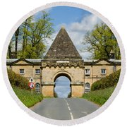 Entrance To Burghley House Round Beach Towel