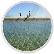 Exploring A Tidal Beach Lagoon Round Beach Towel
