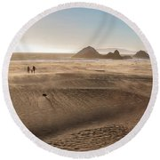 Family Walking On Sand Towards Ocean Round Beach Towel