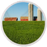 Farm Silos And Shed On Green And Against Blue Round Beach Towel