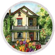 Farmhouse With Spring Tulips Round Beach Towel