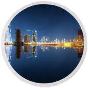 Fascinating Reflection Of Tallest Skyscrapers In Business Bay District During Calm Night. Dubai, United Arab Emirates. Round Beach Towel