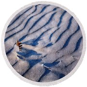 Round Beach Towel featuring the photograph Feather In Sand by Michelle Calkins