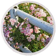 Fence With Pink Roses Round Beach Towel