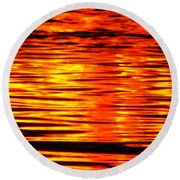 Fire At Night On The Water Round Beach Towel