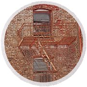 Round Beach Towel featuring the photograph Fire Escape by Marie Leslie