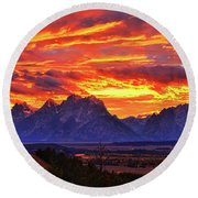 Fire In The Teton Sky Round Beach Towel