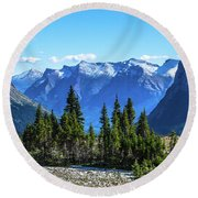 First Winter Snow In Glacier Round Beach Towel by Yeates Photography