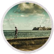 Fishing Along The Malecon Round Beach Towel