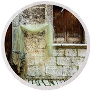 Fishing Net Hanging In The Streets Of Rovinj, Croatia Round Beach Towel