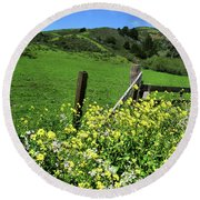 Flowers At The Gate Round Beach Towel