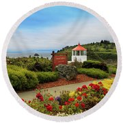 Round Beach Towel featuring the photograph Flowers At The Trinidad Lighthouse by James Eddy