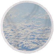 Round Beach Towel featuring the photograph Flying Among The Clouds by Bill Cannon