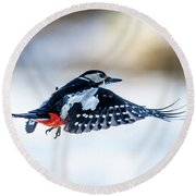 Round Beach Towel featuring the photograph Flying Woodpecker by Torbjorn Swenelius