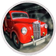 Round Beach Towel featuring the photograph Ford Prefect by Charuhas Images