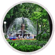 Round Beach Towel featuring the photograph Fountain Through The Trees By Kaye Menner by Kaye Menner