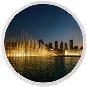 Fountains At Dusk Round Beach Towel