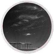 Round Beach Towel featuring the photograph Frisco Pier In North Carolina And Clouds In Black And White by Ranjay Mitra