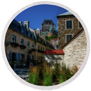 From Below Fairmont Le Chateau Frontenac Round Beach Towel