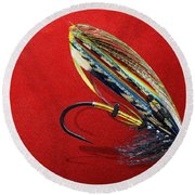 Fully Dressed Salmon Fly On Red Round Beach Towel by Serge Averbukh