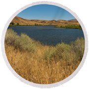 Golden Grasses Along The Snake River Round Beach Towel by Brenda Jacobs