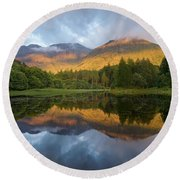 Golden Light At The Torren Lochan Round Beach Towel