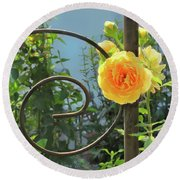 Round Beach Towel featuring the photograph Golden Ruffled Rose On Iron Trellis by Nancy Lee Moran
