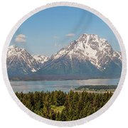 Grand Tetons Over Jackson Lake Panorama Round Beach Towel by Brian Harig