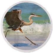 Great Blue Heron Running In The Surf Round Beach Towel