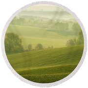 Round Beach Towel featuring the photograph Green Foggy Waves by Jenny Rainbow